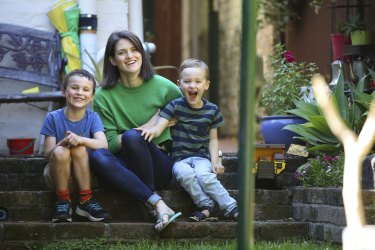 Bronwen Morgan with her two sons, Archie, 6, and Oscar, 4, on the day before school returns.