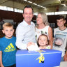 Jet-setting Premier to repay family travel costs after 'insensitive' attacks