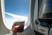 Drinking coffee/tea on a plane iStock image for Traveller. Re-use permitted. Coffee on plane