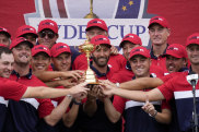 Team USA players and captains with the trophy.