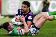 Melbourne Storm's Jahrome Hughes tackles Jack Wighton.