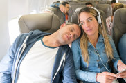 Rude man sleeping on a passenger's shoulder in an airplane while traveling by air - lifestyle concepts iStock image for Traveller. Re-use permitted. Annoying passenger asleep