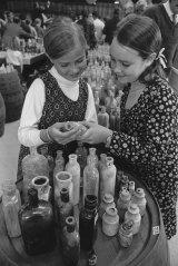 Deborah Pippen and Cassandra Davis examine  some of the bottles up for auction.
