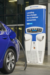 A Hyundai Ioniq at a charging station. Infrastructure Australia has identified a nationwide fast-charging network as a high priority.