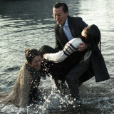 Lap Phanrescuing Jillian Nguyen with Oakley Kwon in a scene from <i>Hungry Ghosts</i>.