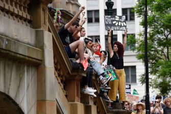 Thousands marched from Town Hall to Hyde Park in Sydney.