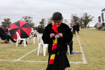 Uncle Lyall Munro's great grand-daughter Armani Munro at his state funeral in Moree.