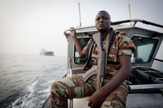 A member of an anti-piracy team from Benin, in West Africa, on patrol in the Bight of Benin in 2011.
