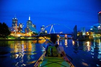 Paddling at night with Kayak Melbourne.