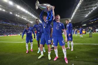 Kai Havertz and Timo Werner of Chelsea celebrate with the Champions League Trophy following their team's victory.