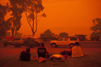 Locals watch the skies after the worst of the fires in Mallacoota on New Year's Eve.