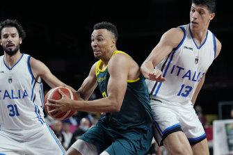 Australia's Dante Exum drives forward against Italy.
