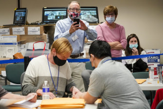 Republican and Democrat observers at work as the ballots were counted in Allentown, Pennsylvania.