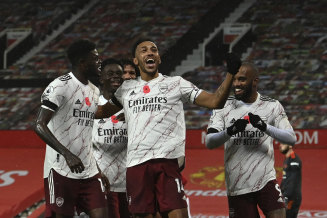 Arsenal talisman Pierre Emerick-Aubameyang celebrates his decisive penalty at Old Trafford.