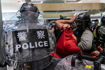 A man is detained by riot police during a demonstration in a shopping mall at Sheung Shui district on December 28. Protesters have been targeting commercial centres during the Christmas period.