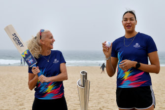 Kerri Pottharst and Liz Cambage try their hand at a bit of cricket.