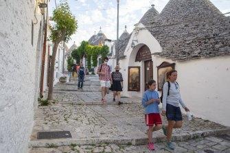 People stroll in the historic centre of Trulli, Puglia, Italy.