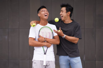 Support network: Li Tu has a laugh with his best mate James ahead of the Australian Open.