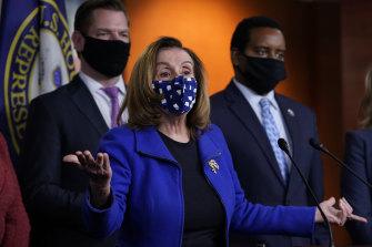 House Speaker Nancy Pelosi with impeachment managers Eric Swalwell and Joe Neguse.