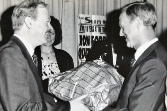 Sun chief sub-editor Kerry Myers presents Ron Ford with a farewell gift on his retirement in 1987.