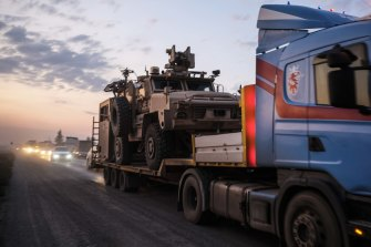 A convoy of US armoured military vehicles leave Syria on a road to Iraq on Saturday in Sheikhan, Iraq.