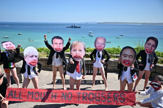 Extinction Rebellion protesters mock the G7 leaders in Cornwall.