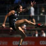 Chloe Dalton of the Blues kicks a goal.
