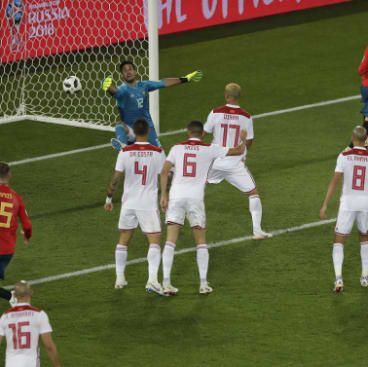 Morocco goalkeeper Munir El Kajoui fails to keep out Iago Aspas' flick.