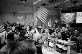 Celebrations on July 24, 1969, at the conclusion of the Apollo 11 mission, from the control room in Houston.