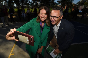 Greens candidate for Macnamara Steph Hodgins-May takes a selfie with party leader Richard Di Natale on Saturday.