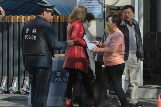 ID cards are checked and facial recognition used when entering almost all public spaces in Urumqi, the capital city of Xinjiang.