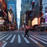 Blaring sirens and empty streets: New York City life grinds to a halt