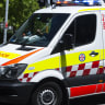 Woman dies in collision between car and bus in Sydney's west