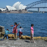 Tourists at Sydney's Mrs Macquarie's Chair