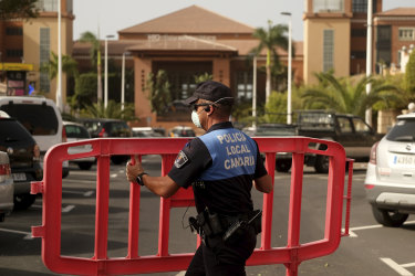A police officer sets a barrier blocking the access to the H10 Costa Adeje Palace hotel in Tenerife, Canary Island.