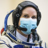 Sole American in space casts her election ballot