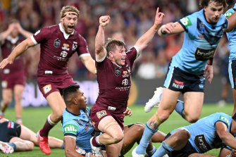 Harry Grant of the Maroons celebrates a try in Origin III.