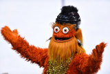 Philadelphia Flyers mascot Gritty, pictured here dressed up for '80s night, has been accused of punching a 13-year-old boy.