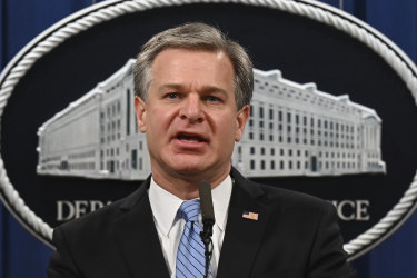 FBI Director Christopher Wray speaks during a press conference at the Department of Justice.