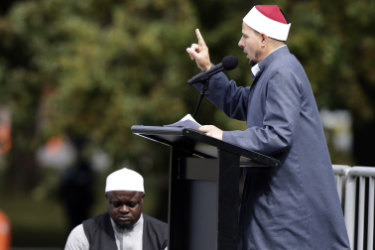 Imam Gamal Fouda addresses Friday prayers at Hagley Park in Christchurch a week after the massacre.