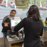 Small change as Woolies ditches controversial trial of cashless stores