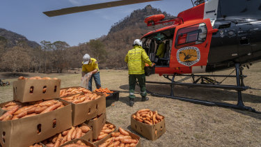 A National Parks and Wildlife Service helicopter prepares for the food drop.