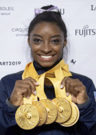 American Simone Biles with her five gold medals.