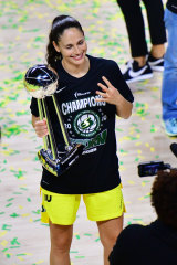 Sue Bird celebrates her fourth WNBA title.