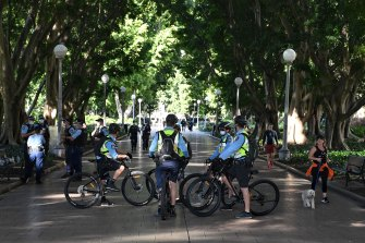 Police patrol Hyde Park on Saturday, to enforce an exclusion zone in place in the CBD.
