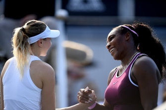 Serena Williams, right, shakes hands with Amanda Anisimova, left, after her semi-final win.