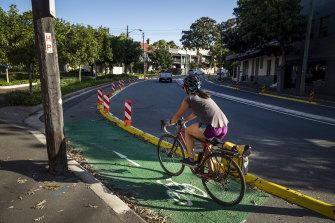 A cyclist travelling along Bridge Road.