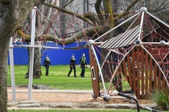 Police patrol Princes Park in Carlton on Tuesday.