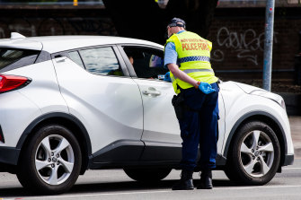 Police speak to a driver at a checkpoint on the Princes Highway when a CBD exclusion zone applied last month.