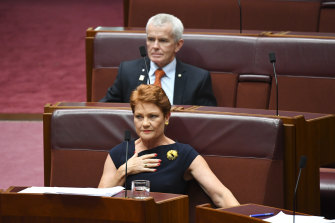 One Nation senators Pauline Hanson and  Malcolm Roberts in February. Their votes are crucial to Labor's bid to wind back a reduction in the time workers have to consider pay and conditions changes.